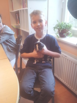 Okko with his guinea pig James Bond
